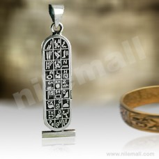 Silver Double Sided Egyptian Cartouche with hieroglyphic symbols table and dark background